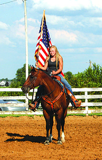 Haley Fauste presented the colors for the National Anthem at the Harrison County Fair Fun Horse Show.