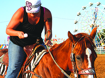 Stacy Miller competes in the Open division of Egg and Spoon at the Harrison County Fair Fun Horse Show.