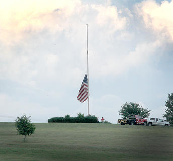 The flag overlooking Flat Run Park was being raised during the National Anthem.