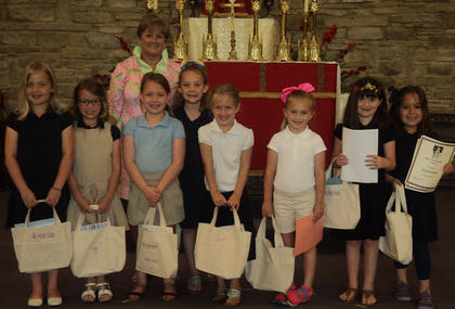 1st Grade Students receiving awards were, from left,  Avonlea Workman, Delaney Koch, Audrey Smith, Felicity Hatfield, Lilly Gribble, Ivy Thornton, Marymichael Gasser, Brynlea Cockrell, Mrs. Henson.