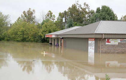 Bell's Sporting Goods and Pawn and  Angilo's Pizza were severely damaged by the flood last weekend.