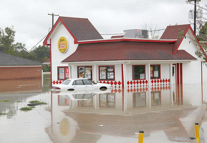 Manager Carrie Livengood, of Lee's Famous Recipe, was unable to move her car before the flood waters rushed in.