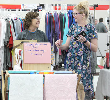 Gaye Noble of Noble Stitches talked with customers about her embroidered products.