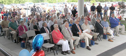 A large crowd was seated under the new canopy near the remodeled front entrance of the hospital. There were several dozen others standing during the ceremony.