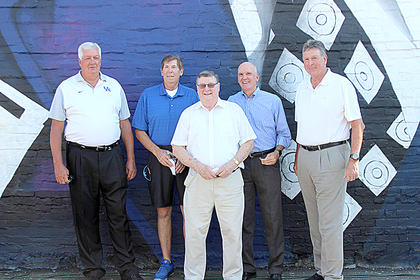 Coach Hall is flanked by several of his former players. From the left, Jim Andrews, Larry Stamper, Kyle Macy and Rick Robey.