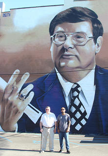 Coach Joe B. Hall and muralist Sergio Odeith stand before the completed work.