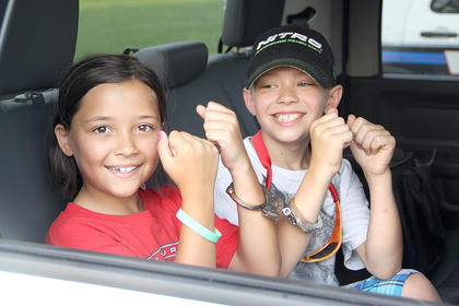 Rylee and Tomas Ballinger experienced being handcuffed in the back of a sheriff's cruiser.