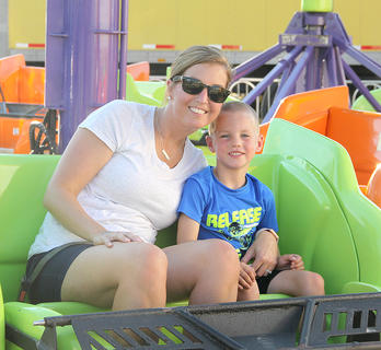 Katie Duffie and son, Calvert, enjoyed the rides together at the fair.
