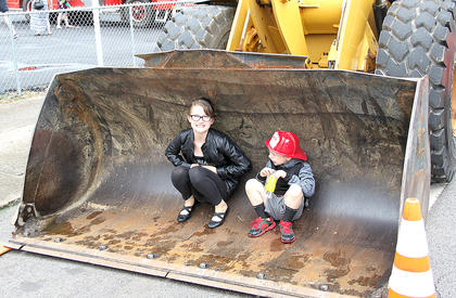 a popular photo spot for parents of their children was in the front-end loader that was on display.