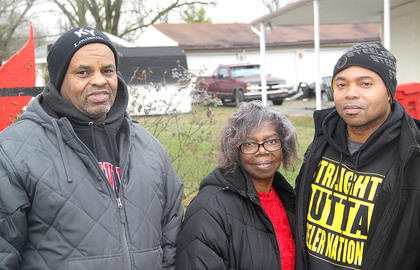 Billy Custard, Pat Walker and her son, Robert Walker, prepare to participate in the Martin Luther King Jr. March in Cynthiana on Monday
