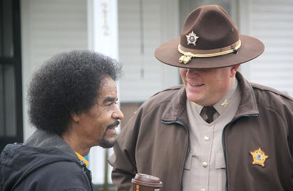 Harrison County Sheriff Shain Stephens and John Rankin talked just prior to the march getting underway on Monday.