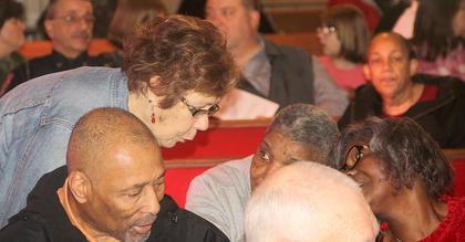 Mary June Brunker talks with Robert Walker, Kay Hill, and Pat Walker at the day's celebration.