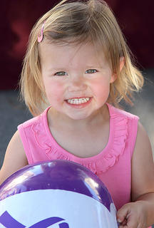 Madison Barnes played with her Relay for Life ball on Saturday night.