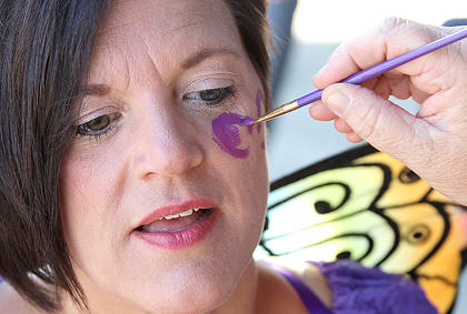 Missy Lutz had a purple butterfly painted on her face by Laura Stephens.
