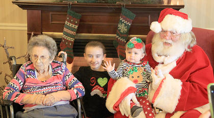 Cedar Ridge resident Clarine Lemons and her great grand children were able to sit with Santa last weekend.