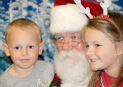 "Children of all ages enjoyed their visits with Santa Claus at the Library last week. They also made ornaments and made some ""reindeer food"" for Rudolph and his gang."