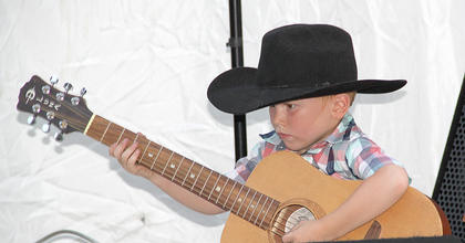 Jacob Molton took the stage and played the guitar along with his dad, George, on Friday night. Later in the show, Jacob's sister, Bracie, also joined George for a father-daughter duet.