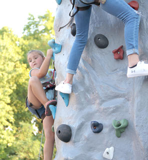 Special thanks go to the E.D. Bullard Company for its funding of the climbing wall that was a big hit for children of all ages at the Summer Concert Series on Friday night.