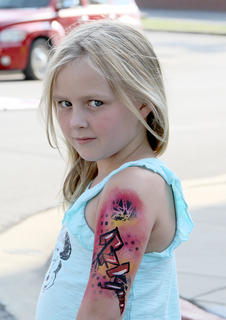 Face painting and temporary tattoos were popular with youngsters.