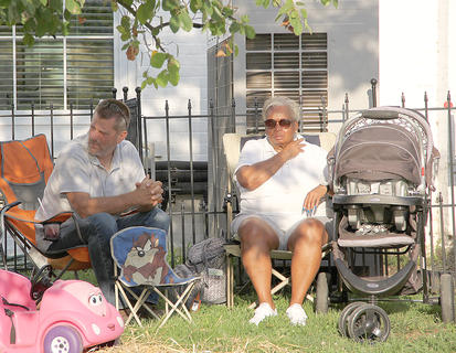 Mike Ritchie and Vickie Wash found a nice spot by the courthouse to listen to the sounds of Neon Shine.