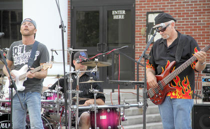 Neon Shine, a four-member country and southern rock band from London, Ky., performed at the last Summer Concert Series event on Friday night, Aug. 10, on Court Street.