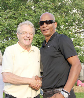Walter Custard, right, couldn't pass up the opportunity to shake hands with the former mayor of Cincinnati, and TV personality Jerry Springer.