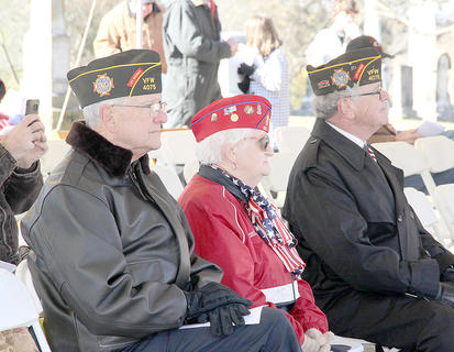 Chuck Duffy, Sue Williams and Jim Snodgrass listened attentively to the Veterans Day proceedings at Battle Grove Cemetery on Sunday.