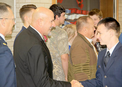 Following the Veterans Day program at HCHS, many stayed around to chat in the auditorium foyer.
