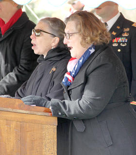 Karen Bear, left, and Carol Hyatt performed a duet of God Bless America at the Veterans Day ceremony on Saturday. Bear also performed the National Anthem and Hyatt sang a medley of Armed Forces songs.