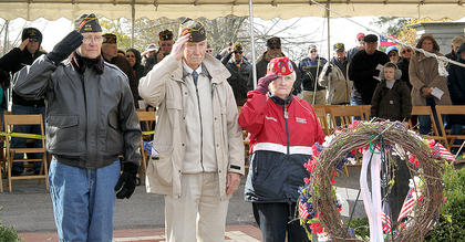 On the left, three veterans who currently live in Harrison County were selected to be wreath presenters at Saturday's Veterans Day ceremony at Battle Grove Cemetery. From the left are Chuck Duffy, Noel Phillips and Sue Williams.