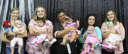 Class II Girls (3-6 months). From left, Neela Renee Farrell, first place; Daely O'Brien, second place; Alisha O'Brien, third place; Lakelee Martin, cutest smile; Maisyn Lanter, best attire.