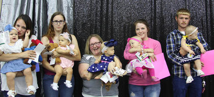 Class III Girls (6-12 months). From left, Anna Carter, first place; Hailey Sidles, second place; Kendra Wilson, third place; Olivia Conley, cutest smile; Bentley Katherine Denkins, best attire.