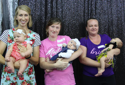 Class I GIRLS (0-3 months). From left, Tamzyn Michelle Meyer, first place and best attire; Harley Choate, second place; and Julie Elizabeth Hensley, third place and cutest smile.