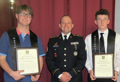 United States National Guard Scholarships. Presented to Corey Wagoner, left, and Buddy Burns by Sgt. Jason Simpson, center.