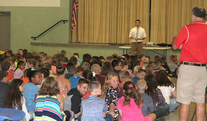 Jon Hoskins, Westside Elementary Principal, begins the first day of school with introductions and announcements.
