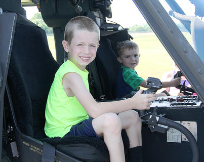 These two youngsters enjoyed taking the controls of the Blackhawk helicopter.